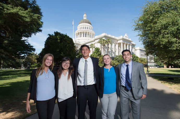Students standing in front of Capitol building