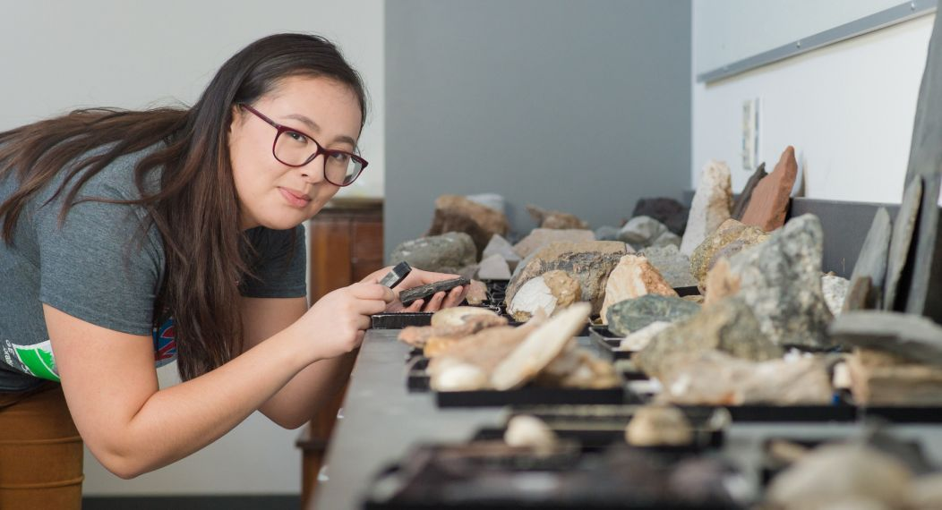 student studying rocks in classroom