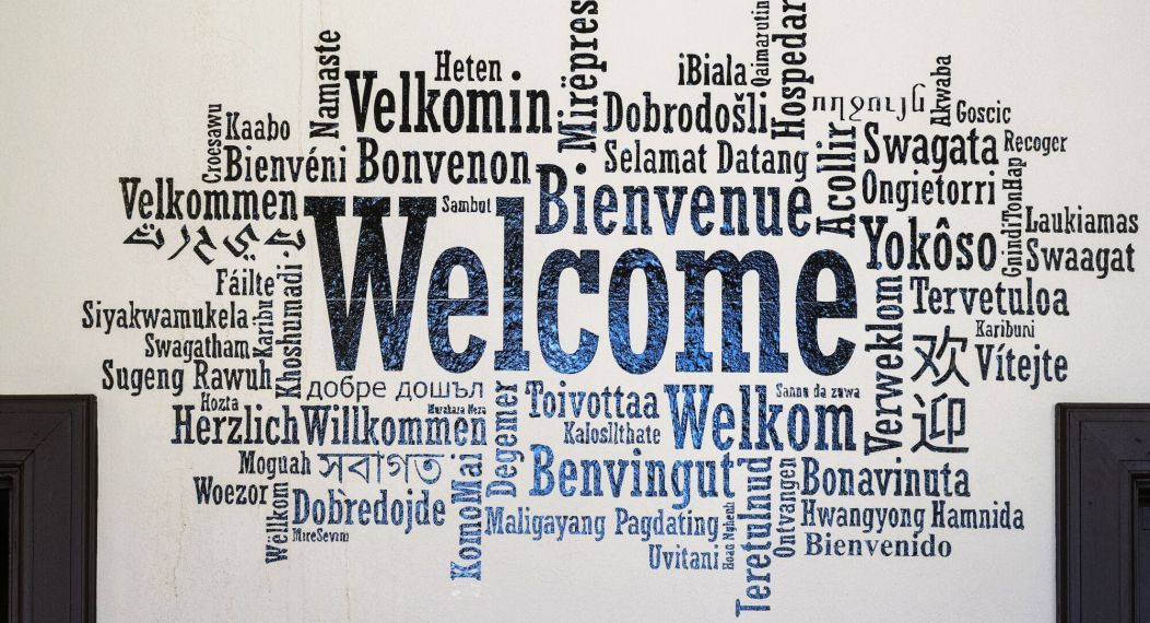 welcome sign written in many languages