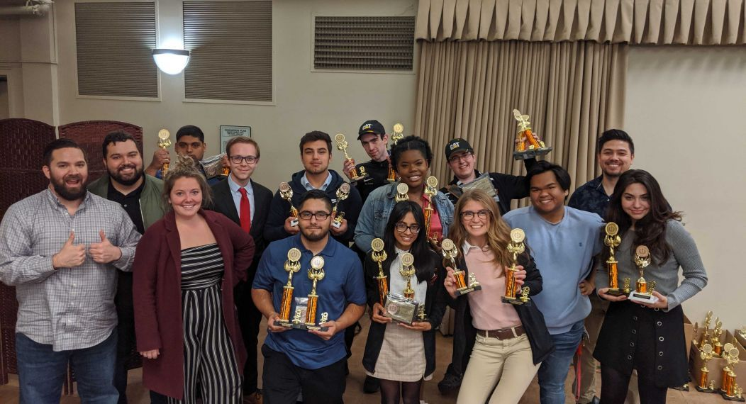 Debate team holding awards