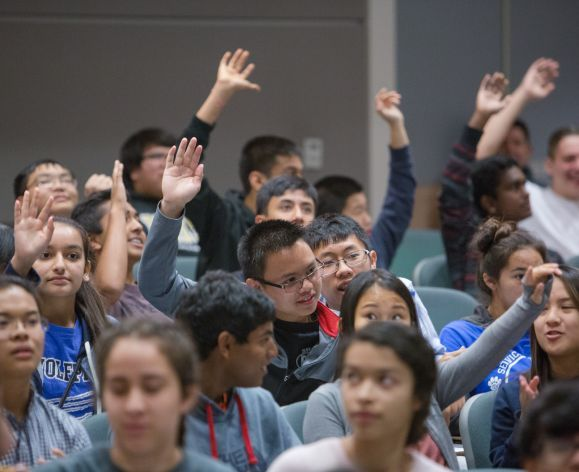 high school students raising hands